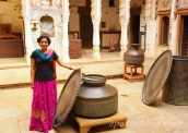 With ancient cooking vessels!